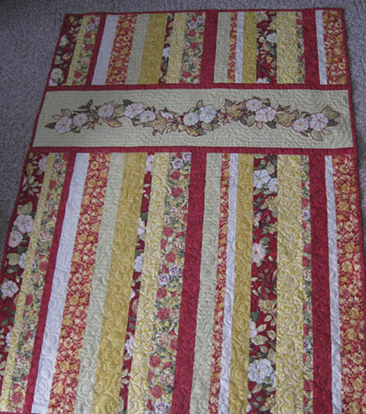 Meadow Ribbon Quilt Free Pattern designed by Jo-Ann Fabric and Craft Stores