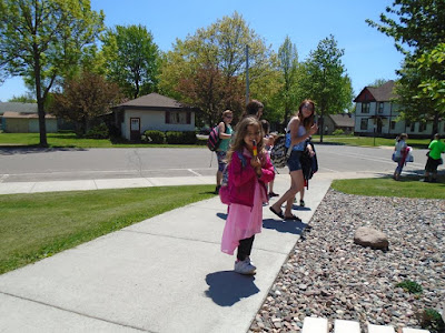 kids of all ages enjoy ice pops in front of the library