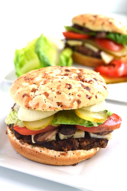 These Mushroom Black Bean Burgers give store bought veggie burgers a run for their money! Simple to make and loaded with veggies and flavorful portobello mushrooms. www.nutritionistreviews.com
