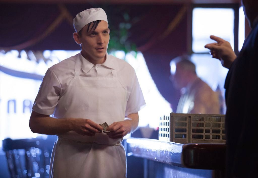 Robin Lord Taylor as Oswald Cobblepot The Penquin working in a restaurant in Fox Gotham Season 1 Episode 3 The Balloonman