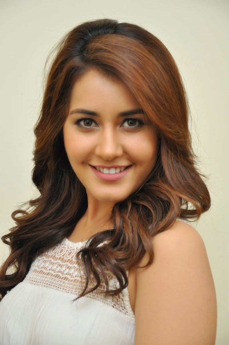 South Indian Actress Rashi Khanna Stills In White Dress At Jil Movie Success Meet