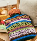http://www.letsknit.co.uk/free-knitting-patterns/LK72-fair-isle-hot-water-bottle