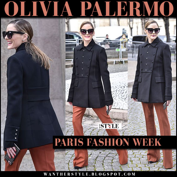 Olivia Palermo in black military coat, burnt orange trousers with black sunglasses perverse dawn patrol what she wore paris fashion week 2017