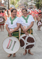 Warm Motherly Duo Smiles Cultural Parade Participants