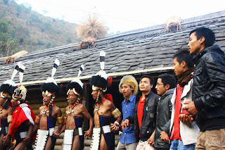 Young folks join the Khiamniungan Naga tribesmens in a traditional dance