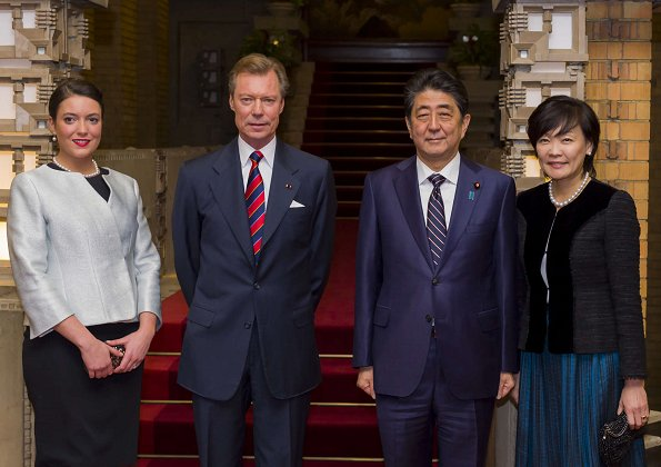 Prime Minister Shinzo Abe and his wife Akie Abe, Grand Duke Henri and Princess Alexandra. Style, silver coat