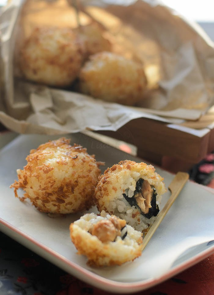 Deep fried cooked sushi rice, filled with teriyaki chicken.