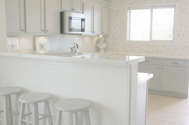 Serene Nordic French kitchen grey and white kitchen with marble statement wall and quartz countertop DIY Kitchen Makeover: Calacatta Marble Accent Wall