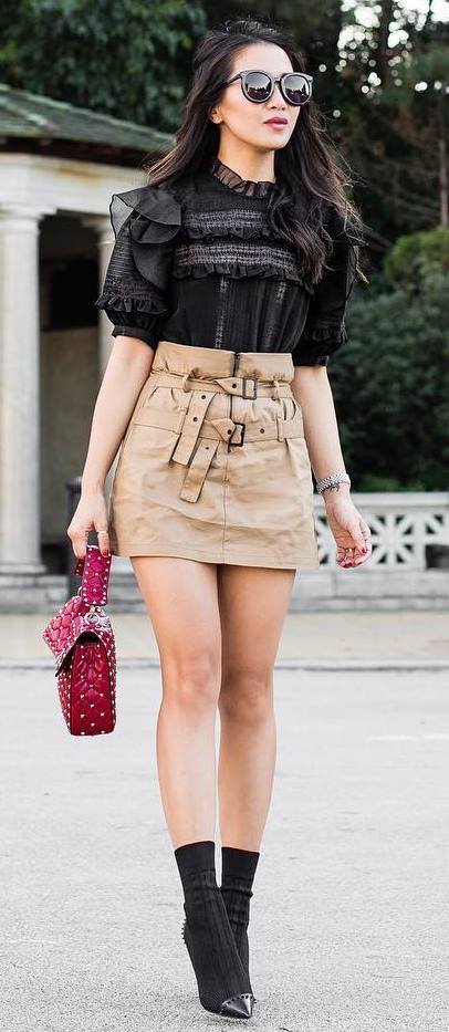 how to style a nude skirt : black blouse + bag + boots