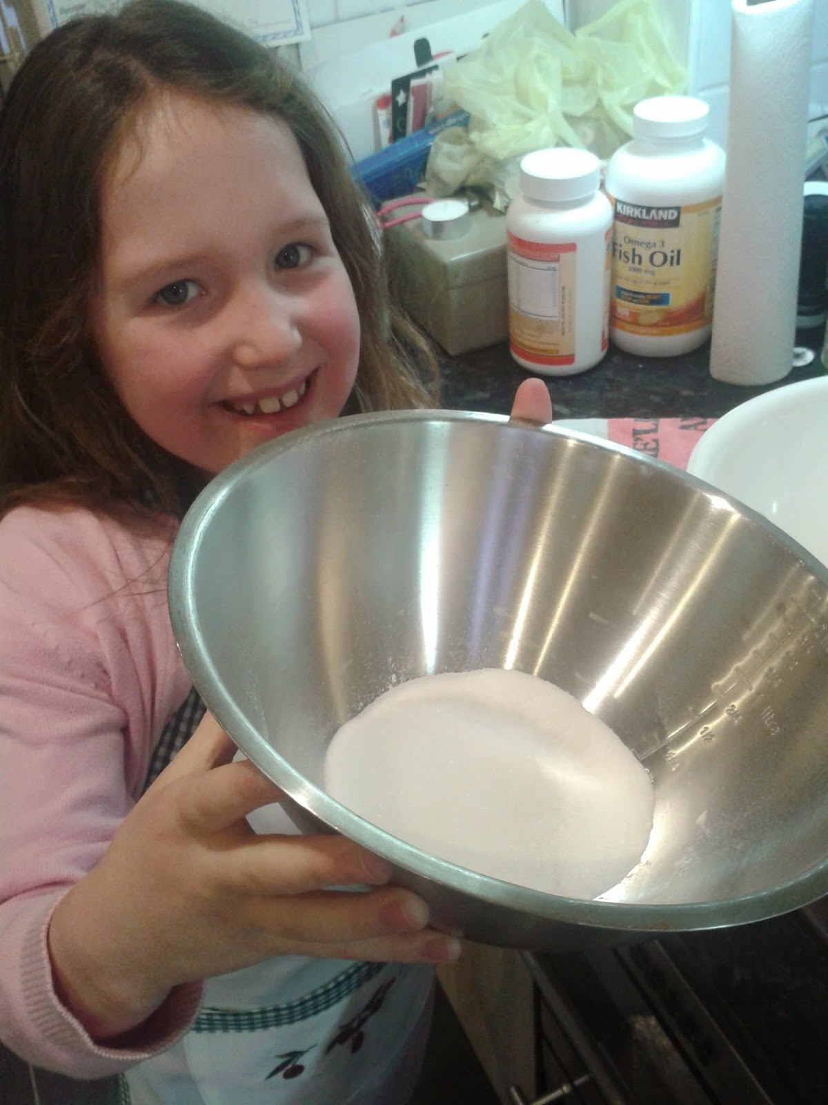 Welsh cakes recipe - Caitlin holding a bowl of sugar