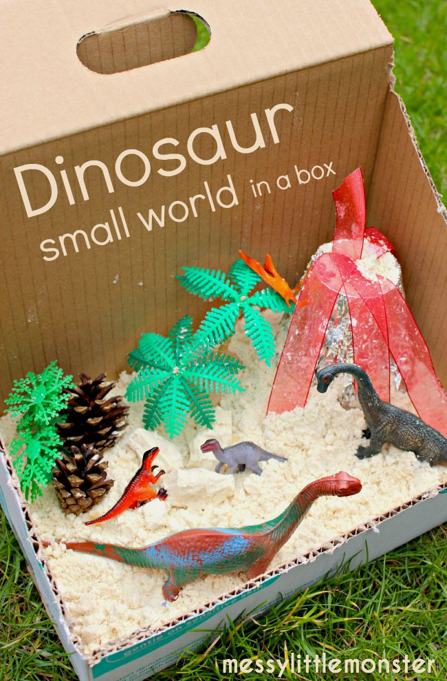 Dinosaur sensory small world in a box with cloud dough