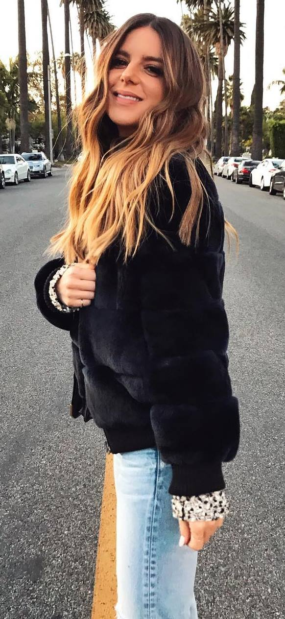 black fur jacket and jeans
