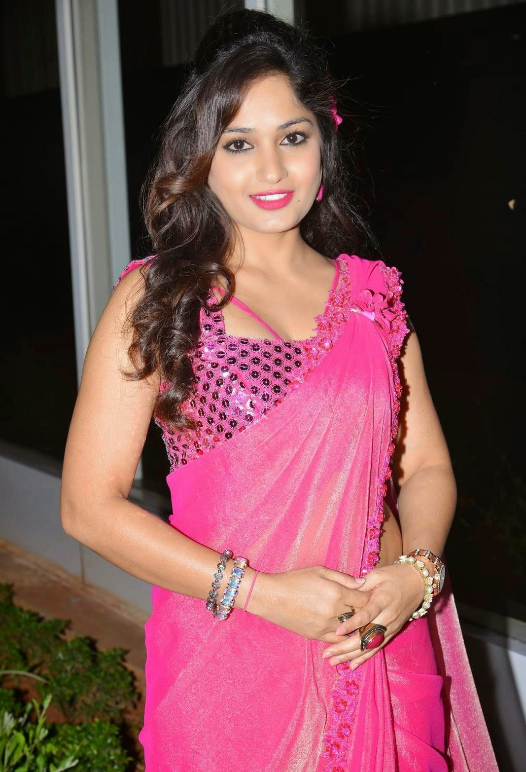 South Indian Actress Madhavi Latha Long hair Hot Hip Navel Stills In Transparent Pink Saree