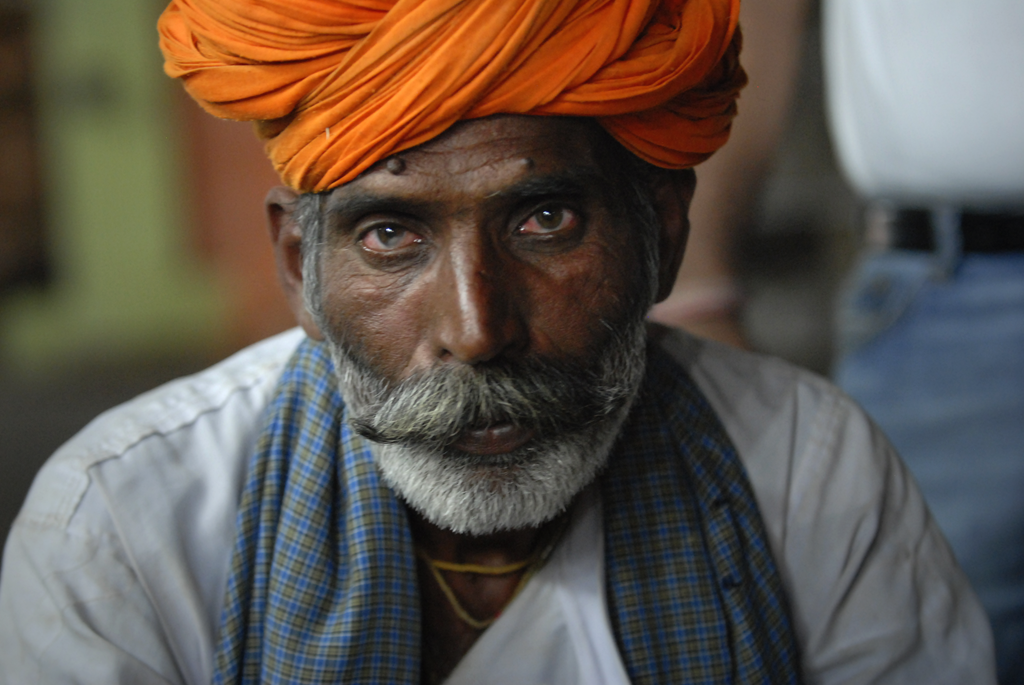 Rajasthani man in Pushkar, India photographed at the Main Marget Rd in the evening by the photographer.