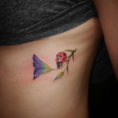 side ladybug tattoo