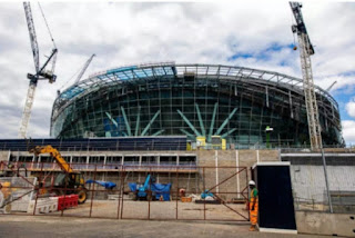 Tottenham have been warned that their new stadium might not be completed until March of next year.