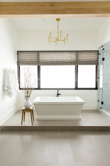 Raised floor in bathroom with freestanding tub