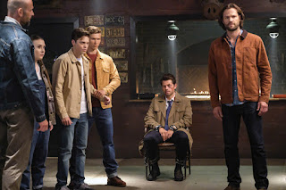 "Alexander Calvert as Jack, Misha Collins as Castiel, and Jared Padalecki as Sam Winchester in Supernatural 14x01 ""Stranger in a Strange Land"""