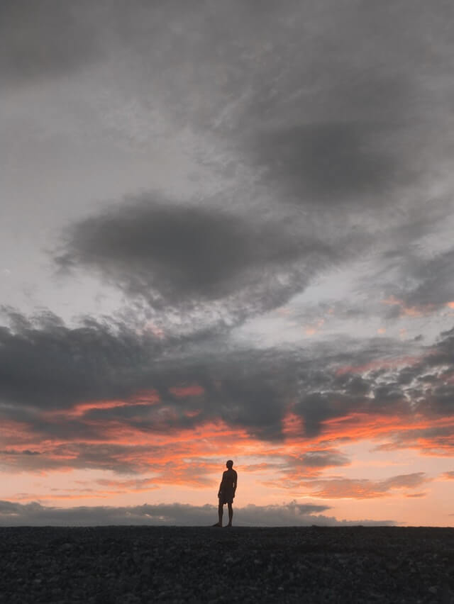 Silhouette of Man Standing Underneath Gray Sky HD Copyright Free Image