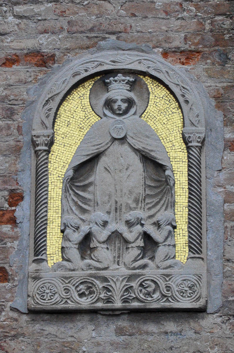 A Virgin Mary bas-relief with gold mosaic on the external wall of a building, Venice, Italy