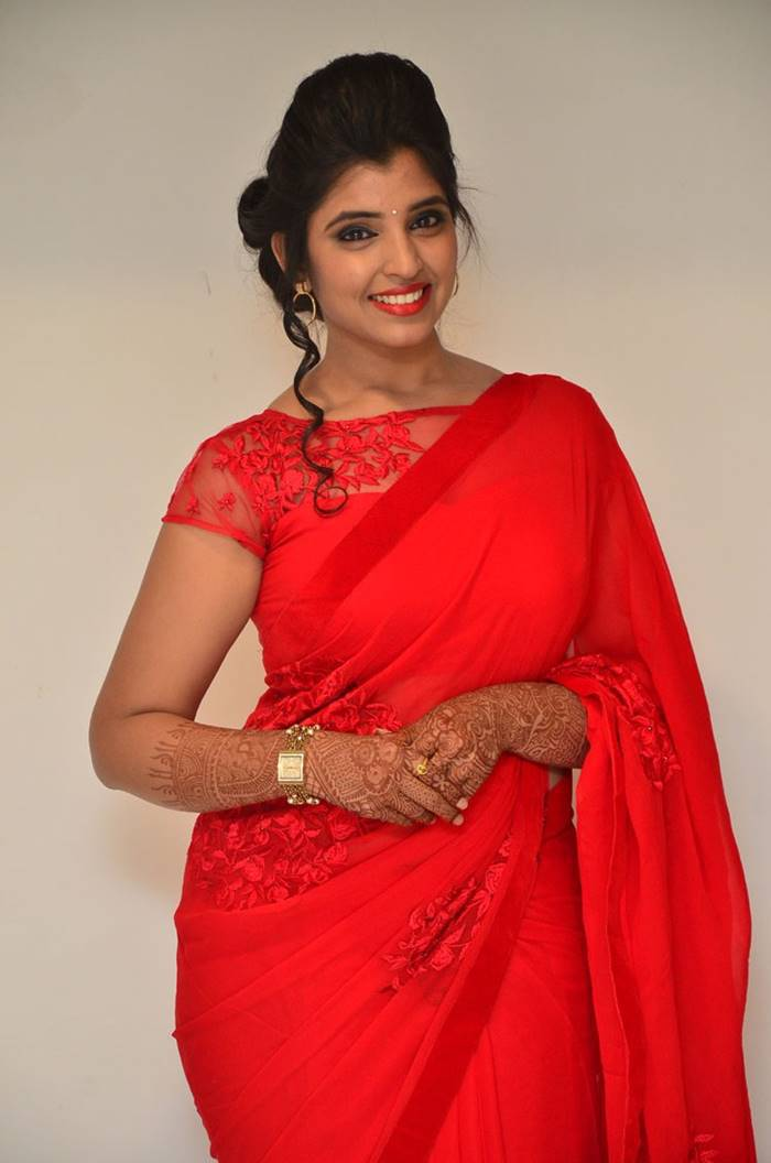 Telugu Anchor Syamala Stills In Red Saree at Film Audio Launch