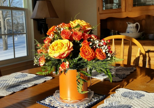 using-flowers-in-your-home-orange-flowers-in-vase-in-sunlight-on-table