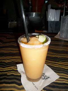 Margarilla- Rainforest Cafe The Recipes Of Disney Ingredients 1/2 cup of ice 1 1/2 oz tequila (Jose Cuervo gold) 1/2 oz triple sec or Cointreau dash of lime juice scoop of orange sherbert orange slice and