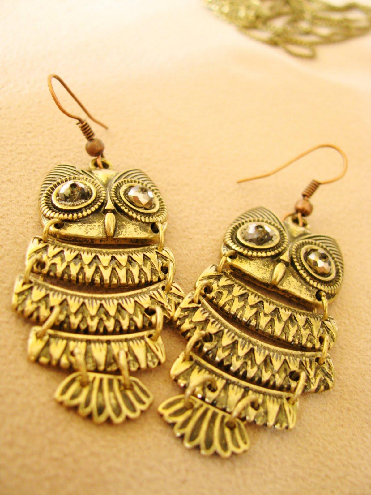 the heart bead: ugly owl earrings