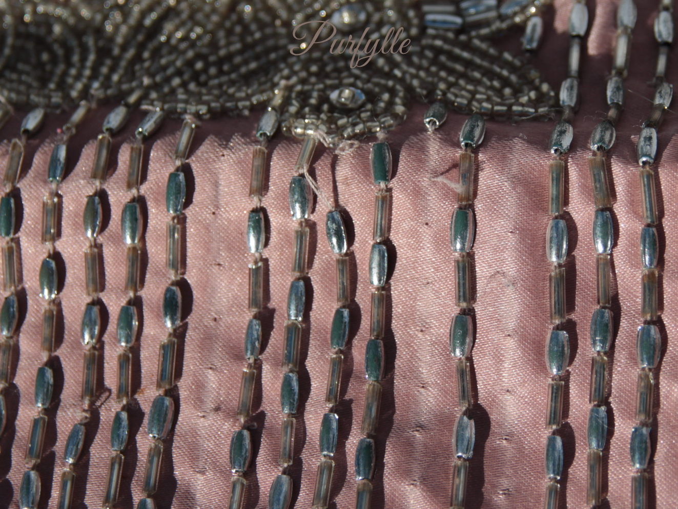 Beaded clutch, if the beads could matched the purse could be repaired