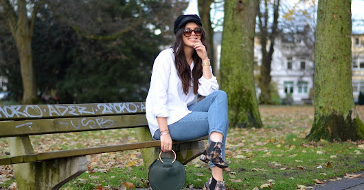 all about the accessoires: baker boy hat, circle bag and floral boots