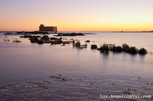 http://fineartamerica.com/featured/lifesavers-building-and-tides-in-fuzeta-angelo-deval.html