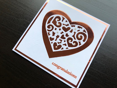 Hand made wedding card with die cut lacy heart, copper mirror card and pearl decorations.