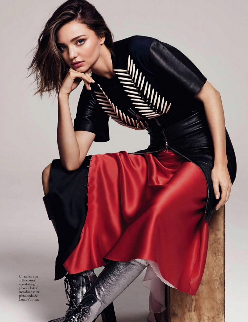 Miranda Kerr wears appliquéd jacket, silk dress and biker boots from Louis Vuitton