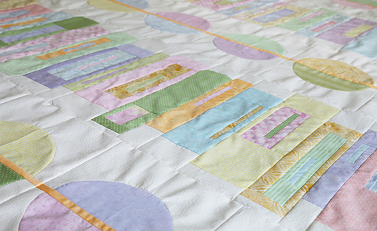 Angled View of Modern Quilt Top in Assorted Pastel Colors