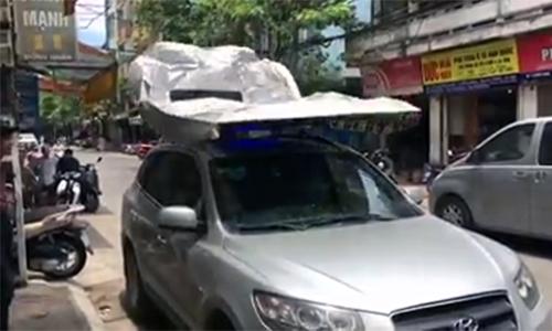Che nắng cho ô tô bằng bạt tự động ở Hà Nội
