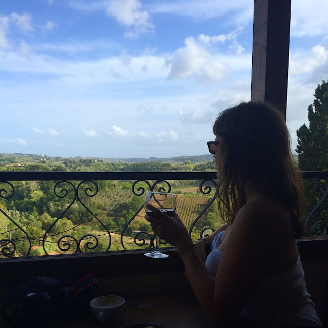 Katy drinking Chianti Red Wine on Balcony at Caffe Centrale San Miniato Tuscany Italy