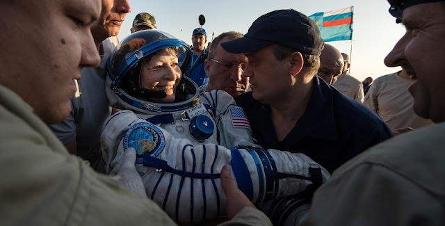 Expedition 52 NASA astronaut Peggy Whitson is helped out of the Soyuz MS-04 spacecraft just minutes after she, and Roscosmos cosmonaut Fyodor Yurchikhin, and NASA astronaut Jack Fischer landed in a remote area near the town of Zhezkazgan, Kazakhstan on Sunday, Sept. 3, 2017 (Kazakh time). Whitson is returning after 288 days in space where she served as a member of the Expedition 50, 51 and 52 crews. Yurchikhin and Fischer are returning after 136 days in space where they served as members of the Expedition 51 and 52 crews onboard the International Space Station. Photo Credit: (NASA/Bill Ingalls)