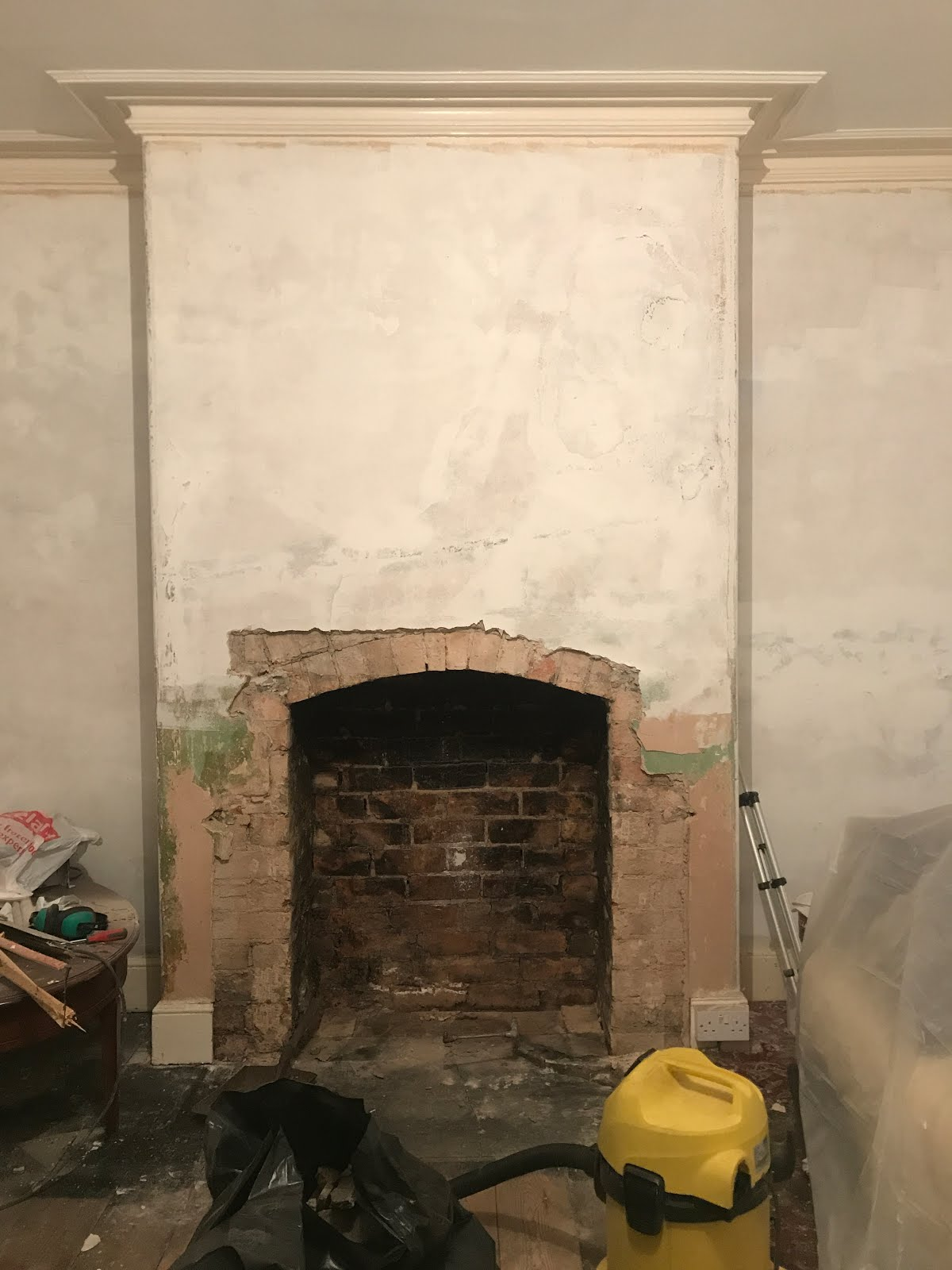 period house with arch chimney in living room