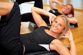 women exercisng in the gym house