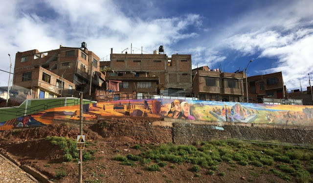 Inka themed mural on retaining wall in outskirts of Puno, Peru