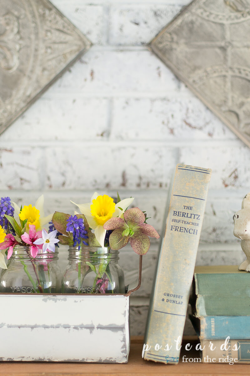 chicken feeder planter with mason jars full of flowers