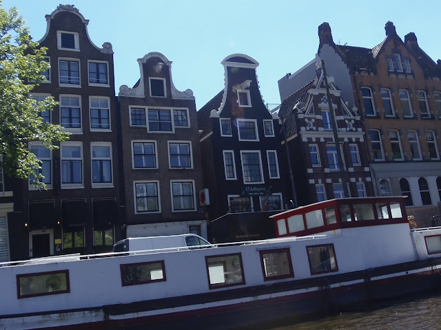 Houses by the canal, Amsterdam http://psychologyfoodandfitness.blogspot.co.uk/2016/07/travel-diary-i-am-amsterdam.html