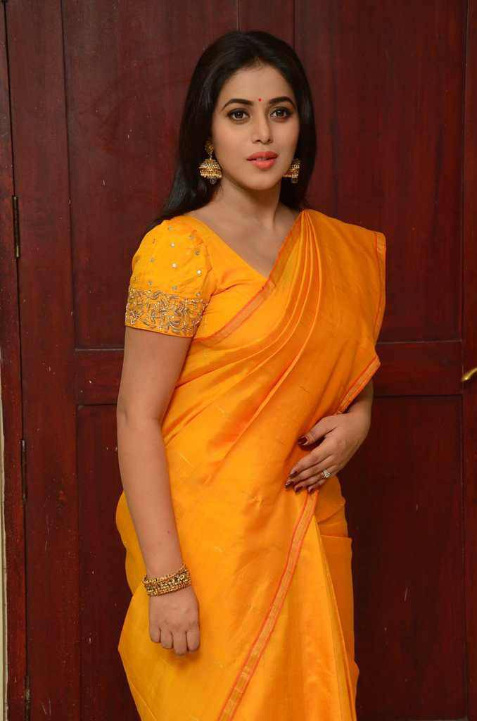 South Indian Actress Poorna Hot Hip Stills In Yellow Saree At Movie Launch