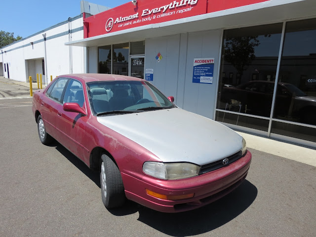 1995 Camry with bad paint and collision damage before repairs at Almost Everything Auto Body