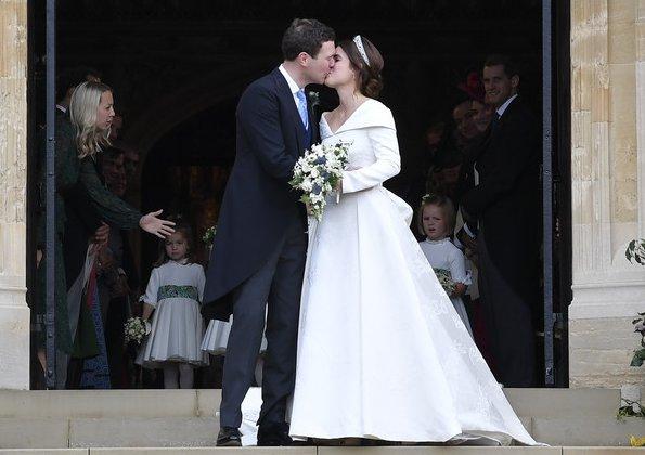Princess Eugenie wore Zac Posen evening gown. Greville Emerald Kokoshnik Tiara, Peter Pilotto wedding dress