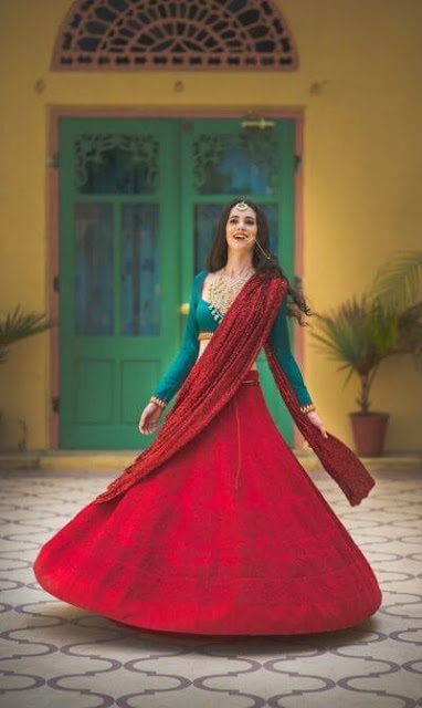 Beautiful Indian Bride In Red  Red Thread Work Lehenga With Dupatta And Teal Full Sleeve Blouse.