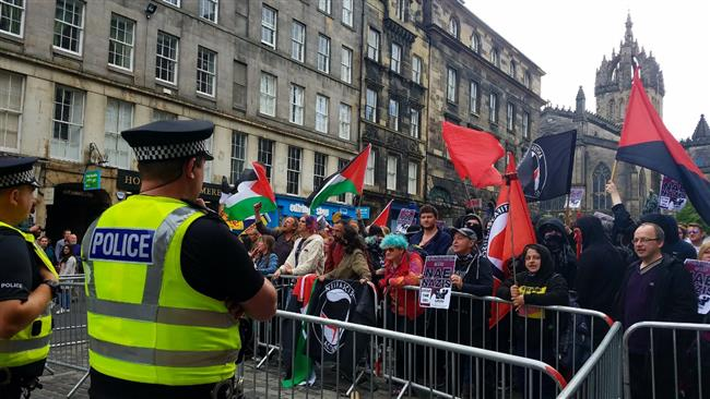Pro- and anti-Muslim protesters face off in Scottish capital of Edinburgh