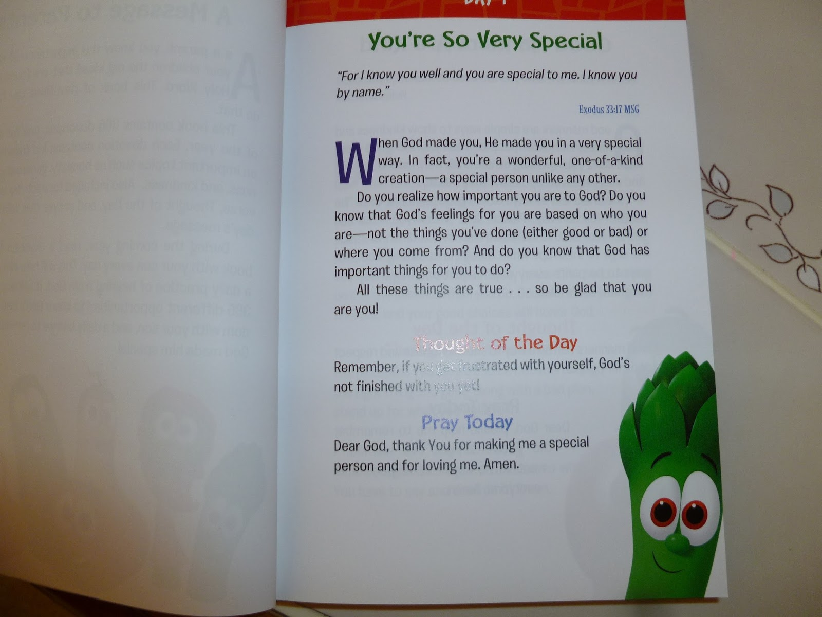 Here is a picture from our book of Day 1. You can see that it's just the  right amount of words for a quick devotional that will keep your kid's  attention.