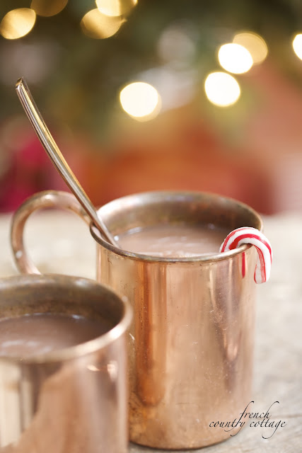 Copper mugs with cocoa Christmas patio