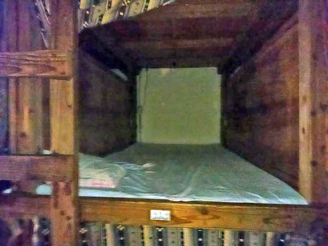 Capsule Hotel, rabbit hutch, ladder, wood, futon, pillow